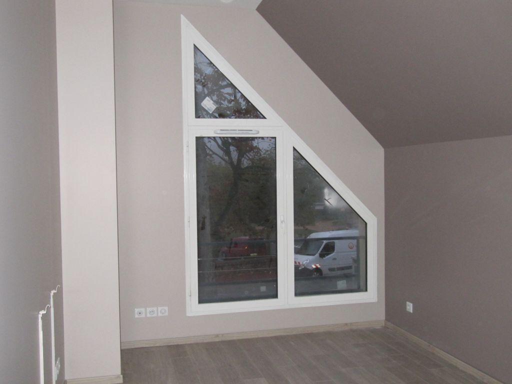 Fenêtre trapèze dans les combles